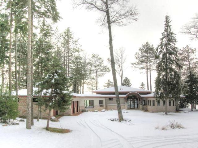 PRICE REDUCTION by $150,000 | Three Lakes Chain Prairie-style Lake Home For Sale