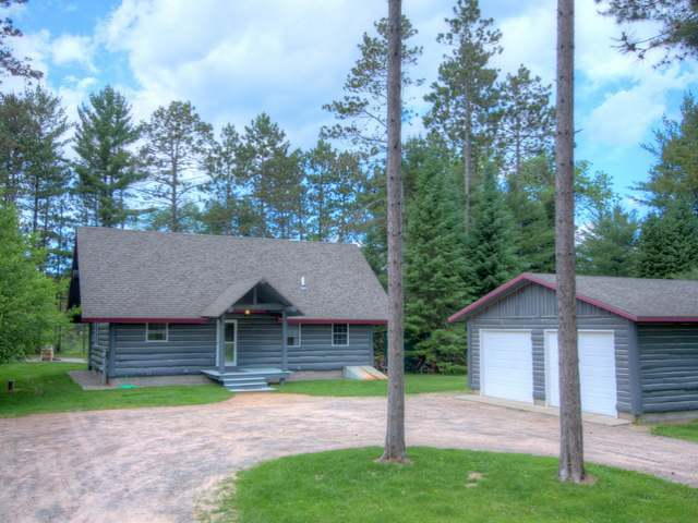 Log Home by Frontier Builders on Eagle River Chain for Sale