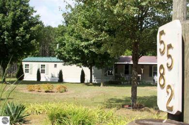 5582 Pine Aire Drive, Grawn, MI 49637