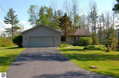407 Lamoreaux, Elk Rapids, MI 49629
