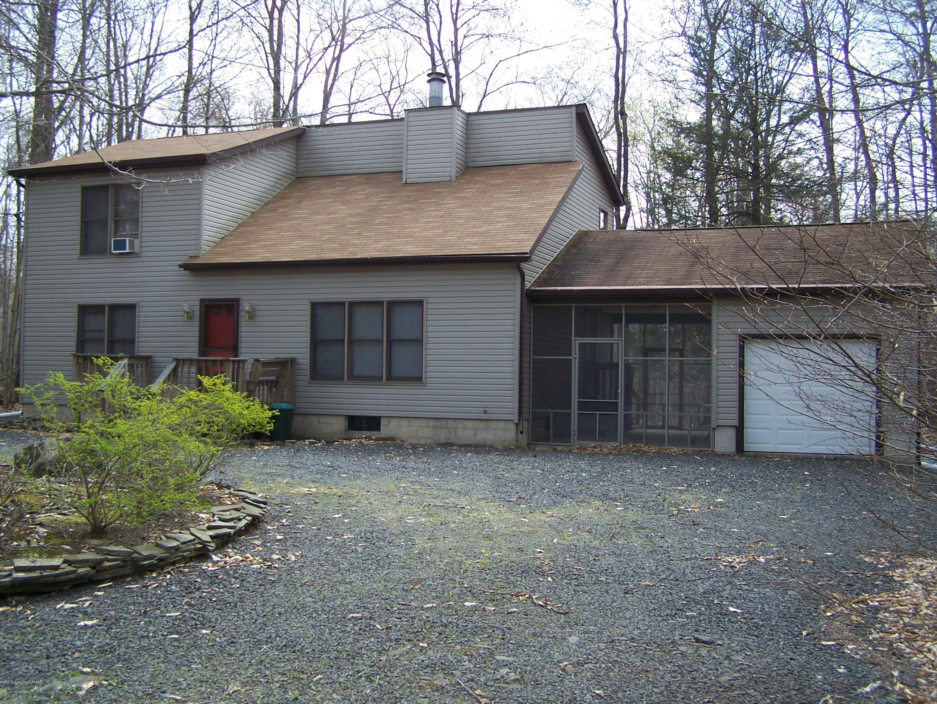2 LOTS FOR THE PRICE OF ONE...Arrowhead Lakes...plus screen porch & garage too